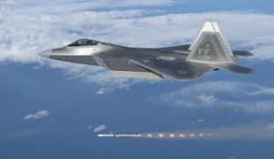 F-22A Raptor #03-4058 from the 27th FS at Langley AFB fires an AIM-120 Advanced Medium Range Air-to-Air Missile